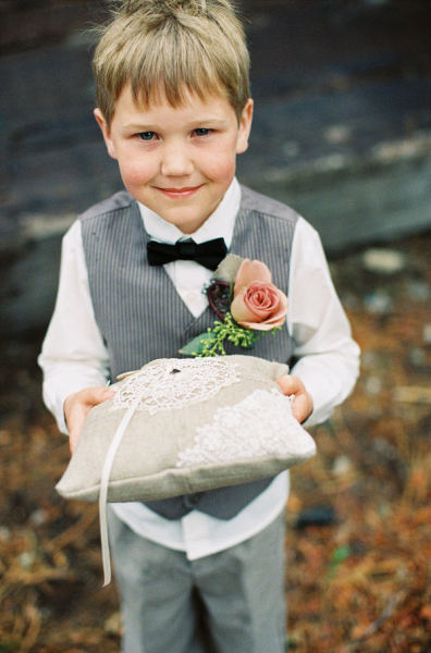 This Ring Bearer Is Ready To Go In A Pinstripe Vest And His Own Boutonniere